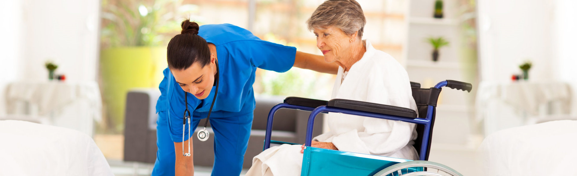 caretaker and her patient on wheelchair