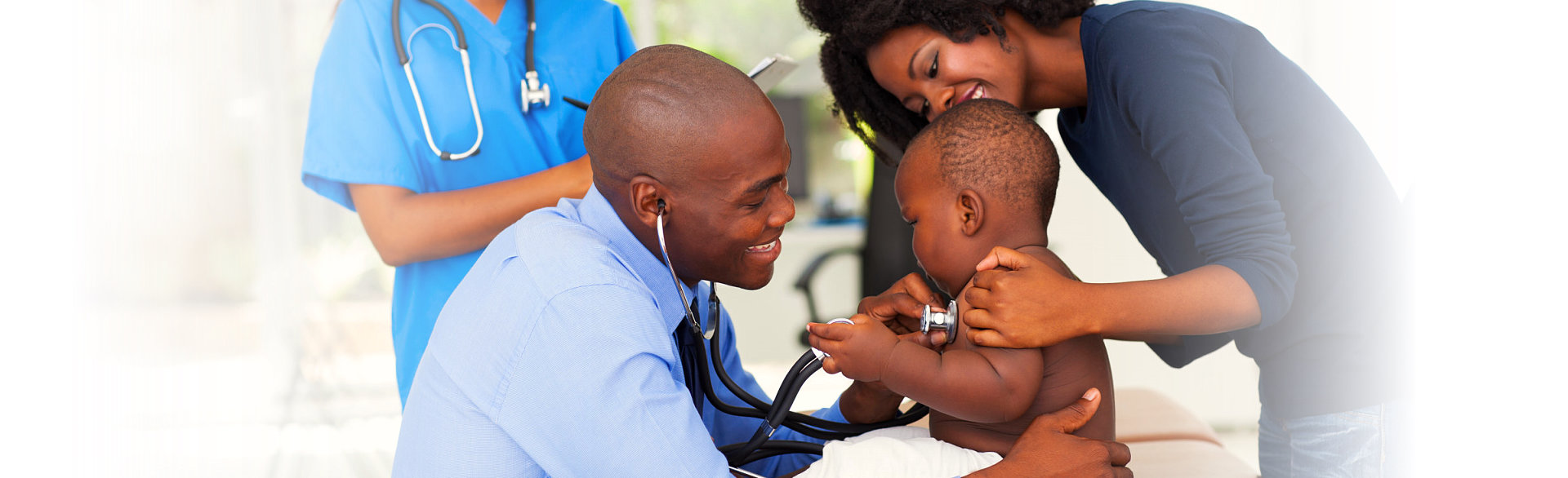 cute little boy being checked by his doctor